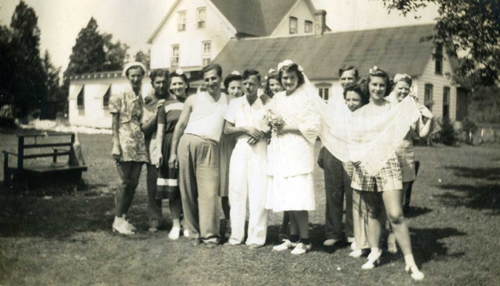 "The bride Florence Schmerfeld (standing by one of Disney's Snow White dwarves) took part in a ""Mock Wedding,"" one of the many fun social activities at Green Acres. A fellow guest was the groom in the ""wedding"" of August 1941. Courtesy of the Bosch Family."