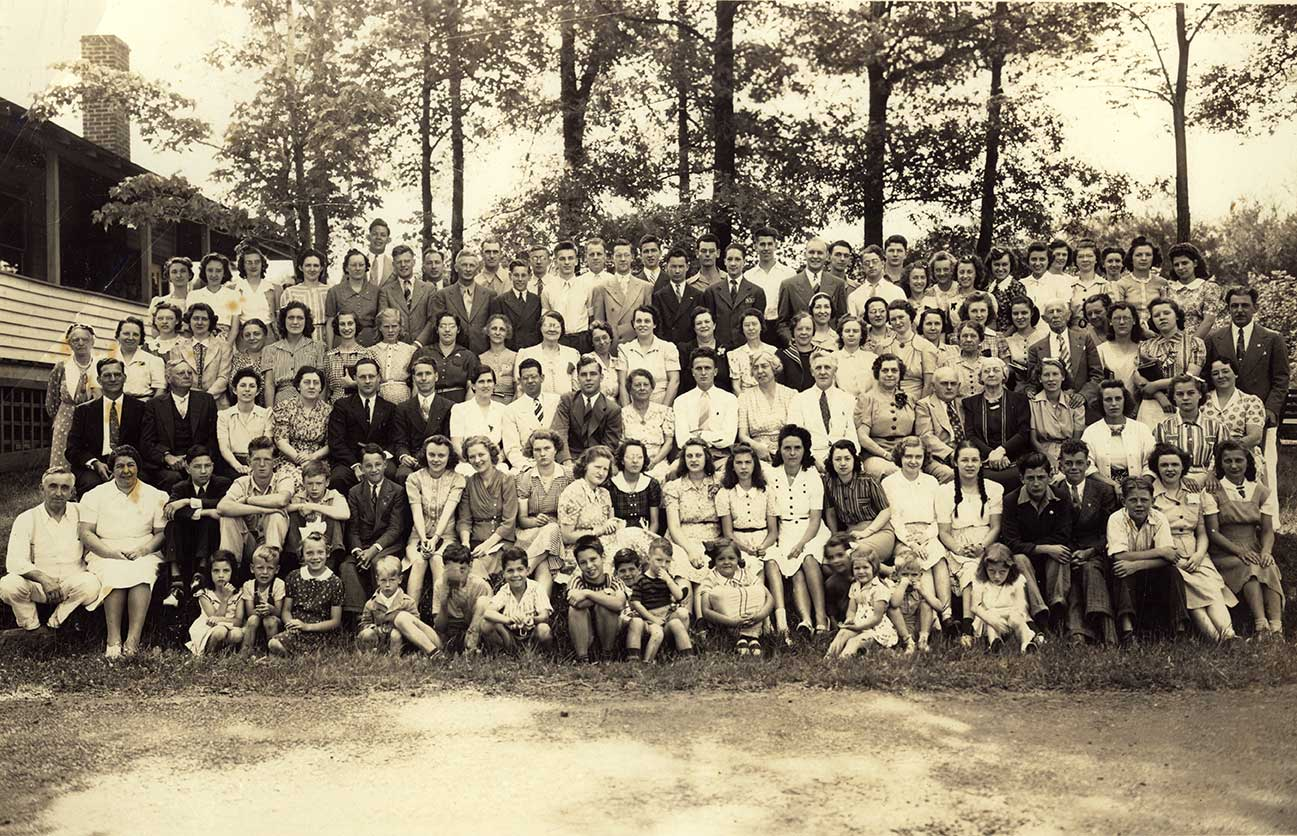 Highland Lake Bible Conference. In back row on right, near second tree in, Mildredand Laura Briggs, unknown, Mary Briggs. front row, four from right, John Briggs.