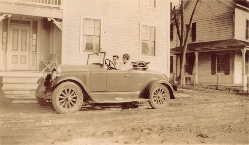 Austin Smith drives the care he bought for his 21st birthday in 1931. The car is in front of Ira Austin's house. Photo courtesy of CW.