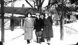 Three unknown young folks in front of the homes facing Proctor Road. where Aida (right) and her brother Lon Austin (left) lived.