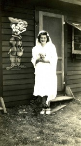 "The"" bride"" Florence standing by one of Disney's Snow White dwarves. Photo courtesy of the Bosch Family."